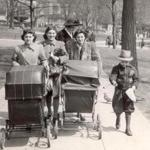 April 28, 1942: Spring had sprung as mothers took their babies for a walk on Boston Common and the pigeons followed along for some treats.
